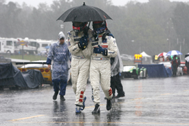 Franck Montagny and Pedro Lamy shelter from the rain at Petit 2009