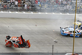 Joey Logano rolls after contact, Dover, 2009