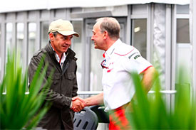 ohn Howett, President, Toyota F1 with Daniel Morelli, manager of Robert Kubica, at the Suzuka paddock