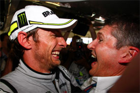 Jenson Button and Nick Fry celebrate winning the title in Brazil