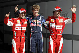 Sebastian Vettel flanked by Felipe Massa and Fernando Alonso, Bahrain 2010