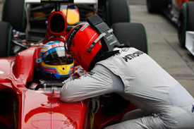 Michael Schumacher approaches Fernando Alonso in the Melbourne parc ferme