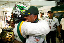 Heikki Kovalainen and Tony Fernandes after qualifying in Malaysia