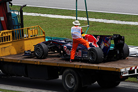Mark Webber's Red Bull is recovered to the pits