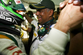 Heikki Kovalainen and Tony Fernandes celebrate