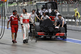 McLaren retrieves Jenson Button's spun car in Malaysian GP qualifying 2010