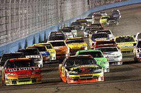 Winner Ryan Newman leads Jeff Gordon at the final restart, Phoenix, 2010
