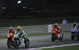Dani Pedrosa challenges Valentino Rossi for the lead in Qatar