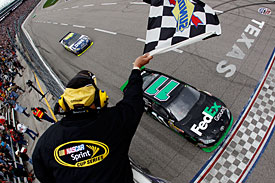 Winner Denny Hamlin takes the chequered flag just ahead of Jimmie Johnson, Texas, 2010