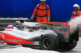 Jenson Button retires his McLaren in Monaco