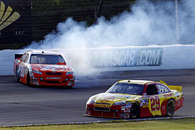 Joey Logano spins after contact from Kevin Harvick, Pocono, 2010
