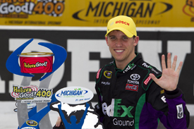 Denny Hamlin celebrates Michigan victory