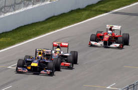 Lewis Hamilton lines up a pass on Mark Webber in Canada
