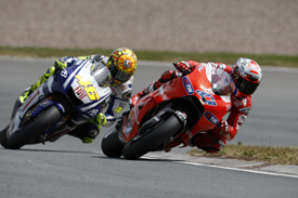 Casey Stoner races with Valentino Rossi in Germany