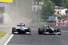 Michael Schumacher squeezes Rubens Barrichello in Hungary