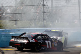 Jimmie Johnson and Denny Hamlin crash at the final turn, Watkins Glen, 2010