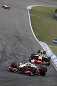 Lewis Hamilton leads Mark Webber in Germany