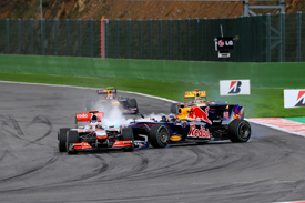 Sebastian Vettel crashes into Jenson Button at Spa