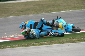 Loris Capirossi crashes at the first corner at Misano