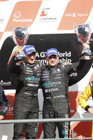Andrea Bertolini and Michael Bartels on the Portimao podium