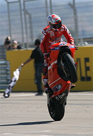 Casey Stoner celebrates at Aragon