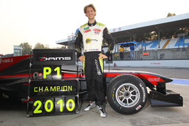 Romain Grosjean celebrates the Auto GP title