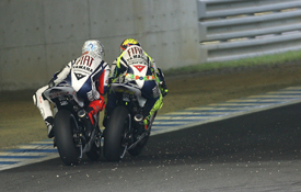 Jorge Lorenzo and Valentino Rossi race hard at Motegi
