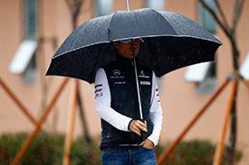 Rosberg arrives on a rainy morning