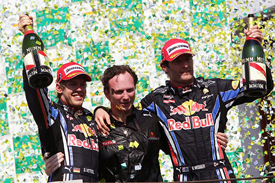 Sebastian Vettel, Christian Horner and Mark Webber on the Interlagos podium