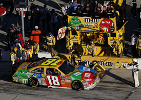 Kyle Busch held in his pit by a NASCAR official, Texas, 2010