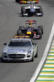 The safety car leads the field in Brazil