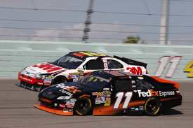Denny Hamlin races with Greg Biffle at Homestead