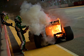Kovalainen extinugushed his burning Lotus in Singapore