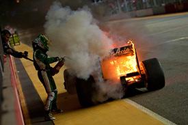 Kovalainen extinugushed his burning Lotus in Singapore