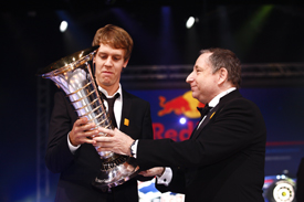Sebastian Vettel receives the world champion's trophy from Jean Todt