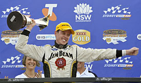 2010 V8 Supercar champion James Courtney celebrates at the Sydney Telstra 500