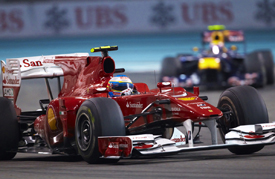 Fernando Alonso's Ferrari leads Mark Webber's Red Bull in Abu Dhabi