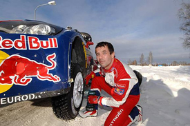 Sebastien Loeb changes a wheel in Sweden