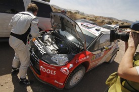 Petter Solberg works to fix his Citroen in Mexico