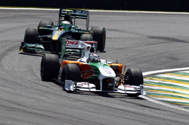 Adrian Sutil (Force India) leads Heikki Kovalainen (Lotus) in Brazil, 2010