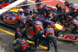 Sebastian Vettel, Red Bull, practices a pitstop in Catalunya testing