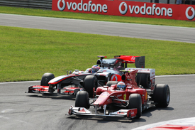 Fernando Alonso races with Jenson Button at Monza in 2010