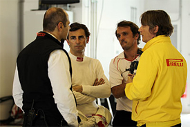 Pedro de la Rosa with Pirelli engineers