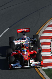 Felipe Massa races against Jenson Button in Melbourne