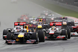 Sebastian Vettel leads at the start at Sepang