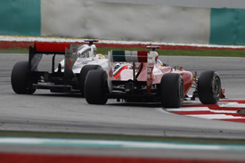 Fernando Alonso races with Lewis Hamilton at Sepang