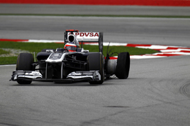 Rubens Barrichello, Williams, with a puncture at Sepang 2011