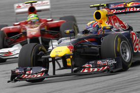 Mark Webber's Red Bull races with Felipe Massa's Ferrari at Sepang