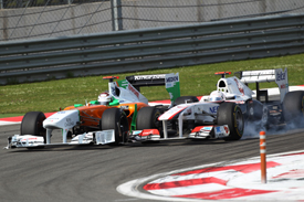 Kamui Kobayashi races with Adrian Sutil in Turkey