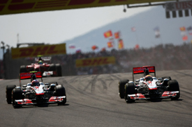 Lewis Hamilton races Jenson Button in Turkey